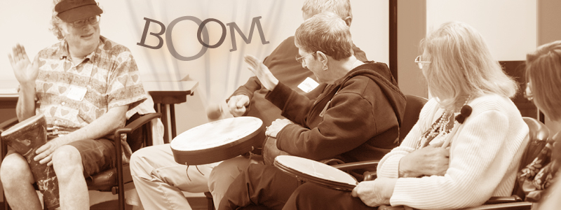 Photo of a group of seniors playing percussion instruments in the Resounding Joy Mindful Music program on-site at the San Diego Alzheimer's Association.