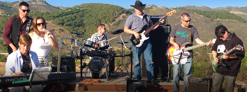 Photo of Semper Sound Band members rehearsing on a hilltop in California.